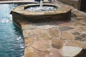 Pool works natural stone and rock waterfeatures rock for Natural stone around pool