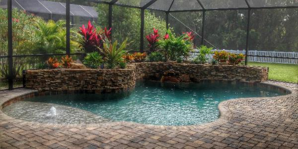 luxury pool with natural stone planter in manatee county