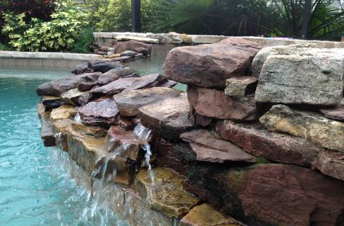 natural stone spillway into pool