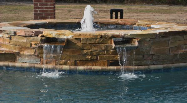 custom Spa with double stone spillways in parrish, fl